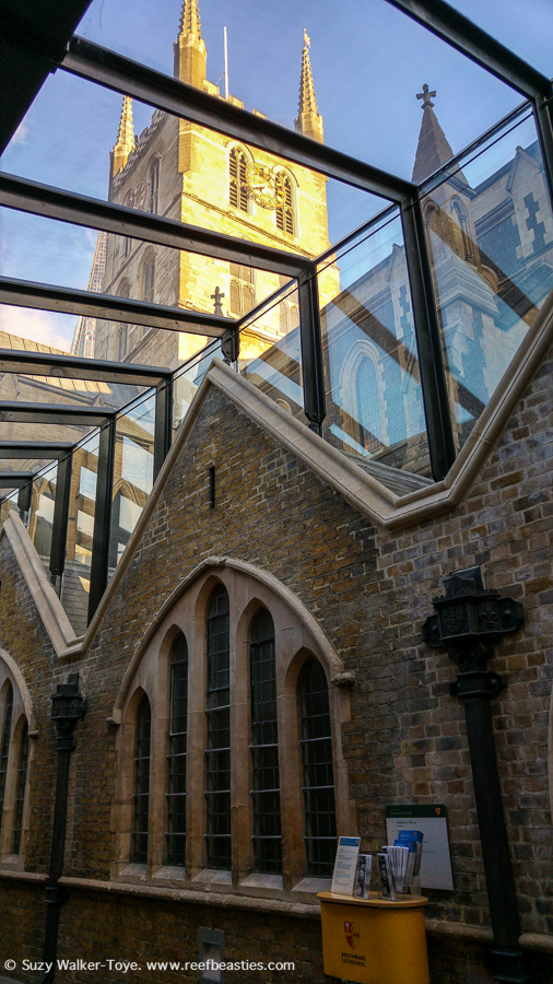 This is a covered walkway which would have been outside the original church, called Lancelot's Link. This shows the exterior view of the North Aisle pointed arched (stained glass) windows