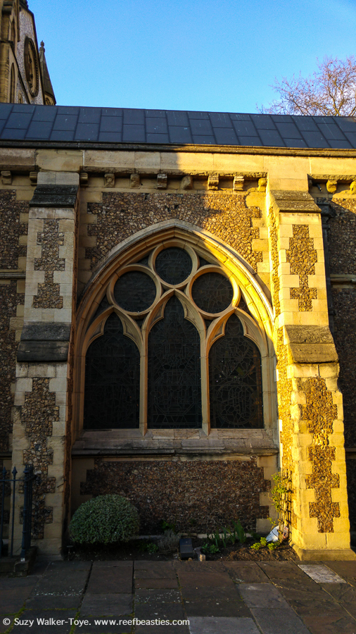 Exterior view of medieval Restrochoir from south east churchyard showing pointed arch windows with geometric tracery