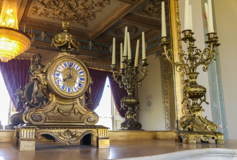 Hylands House - Drawing Room, clock and candlestick on the mantel infront of the mirror